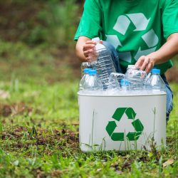 a-woman-collecting-and-putting-plastic-bottles-int-YLTQQYZ